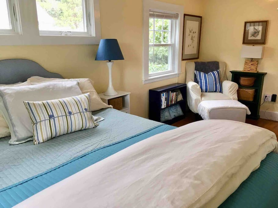 Large bedroom with place to check emails and phone charging station
