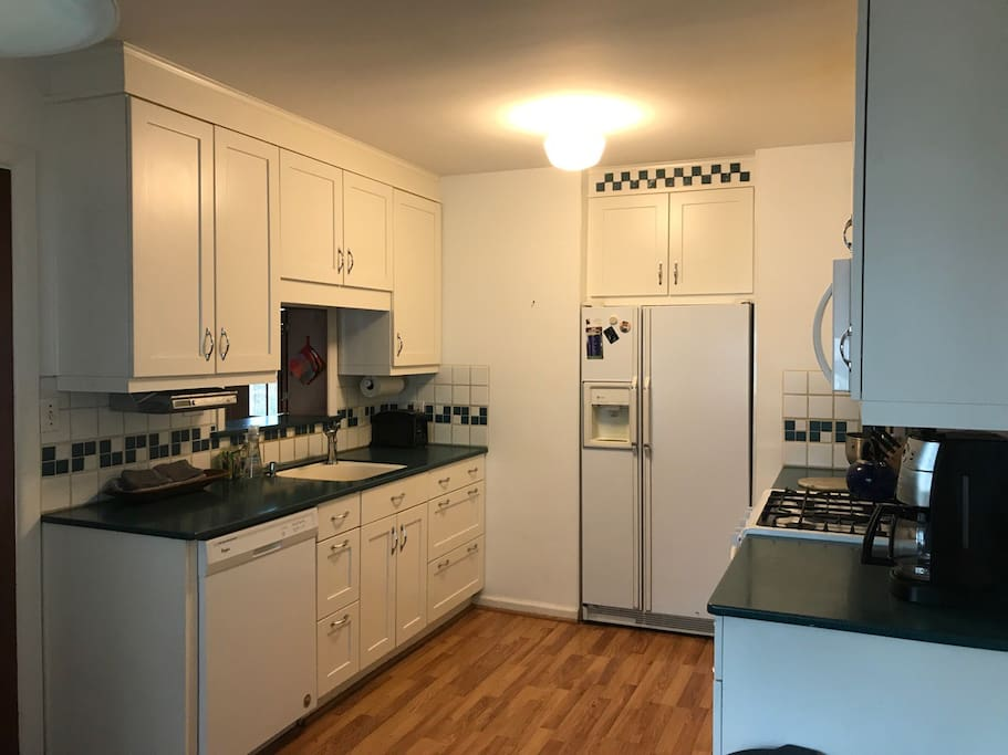 Kitchen with gas stove, dishwasher, and microwave