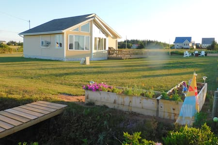 The SunDrop(Reflections By-The-Sea Cottage Rental)