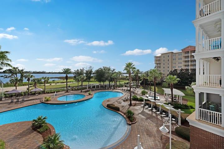 Beautiful waterfront condo w/ bay views, a shared hot tub, & huge community pool