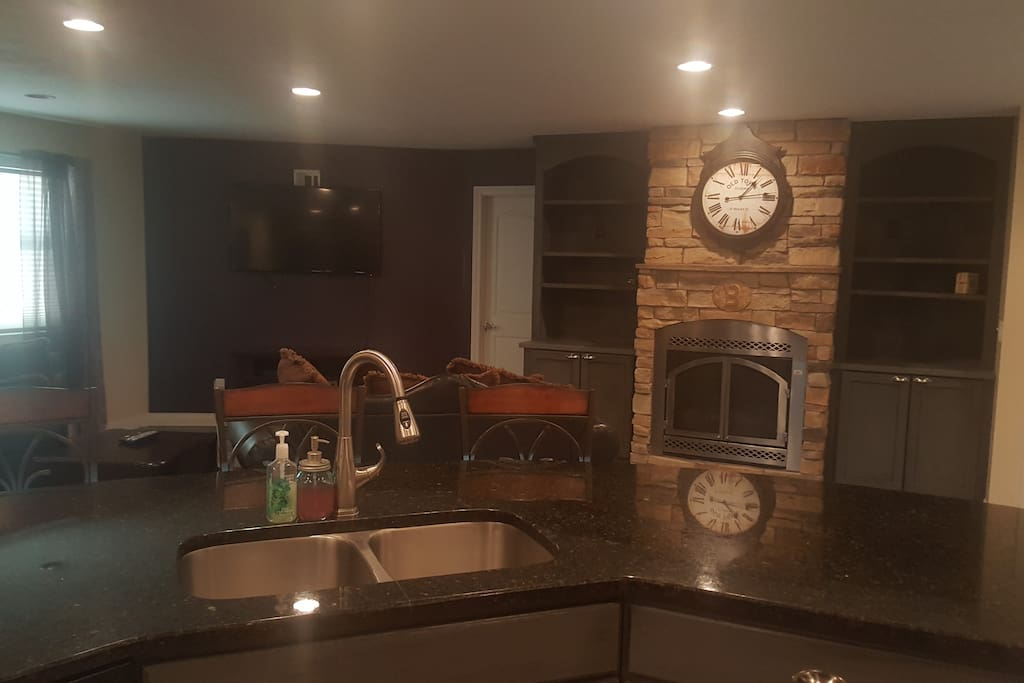 View from kitchen into living room. Gas fireplace, cable and WiFi available