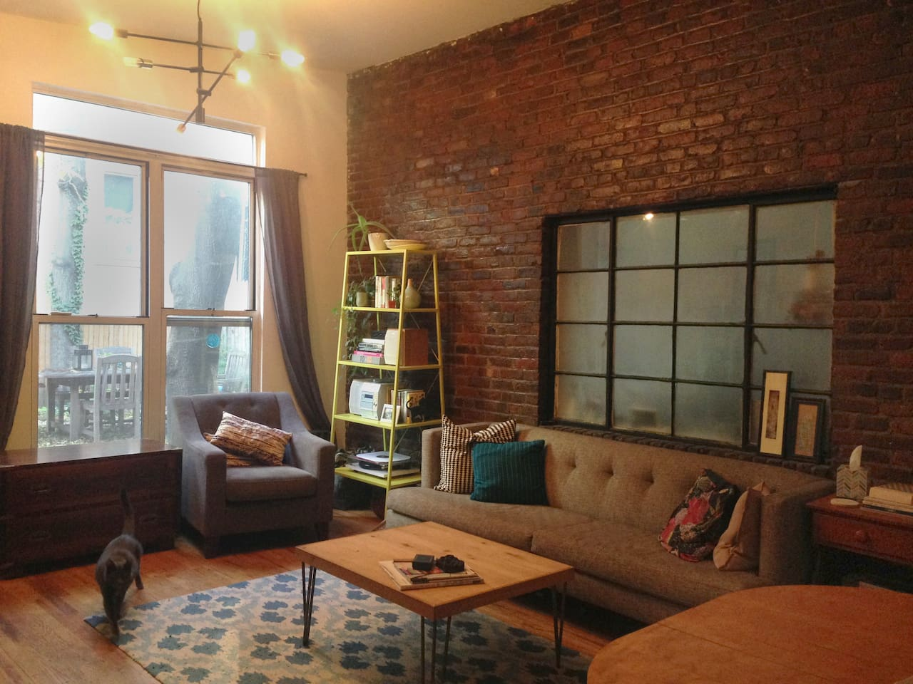 large living room with exposed brick walls!