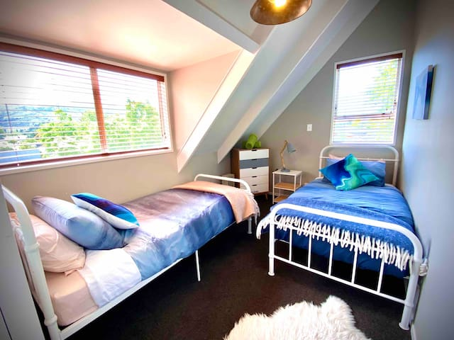 The 'Beach Bedroom' with two single beds, drawers and wardrobe upstairs.