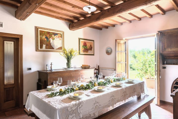 LUNCHROOM LEADS INTO THE TERRACE OVERLOOKING THE TUSCAN HILLS.