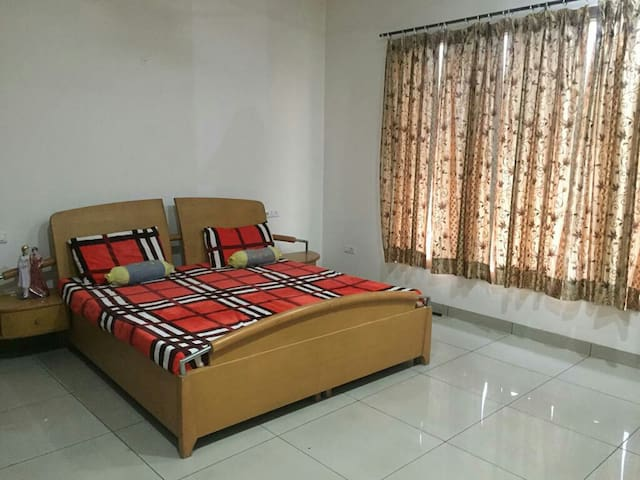 Continental bedroom with attach bathroom