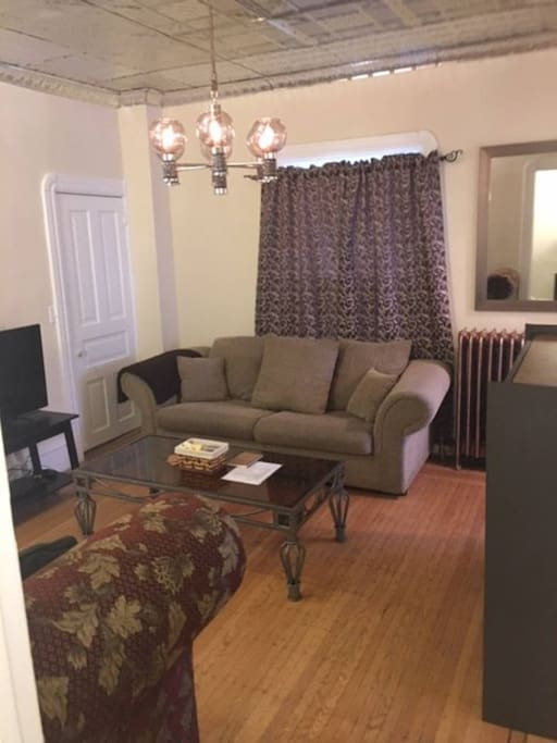 Main floor living room with wifi, cable tv and dvd player, game shelf, lots of seating, comfy pull out queen sofa bed