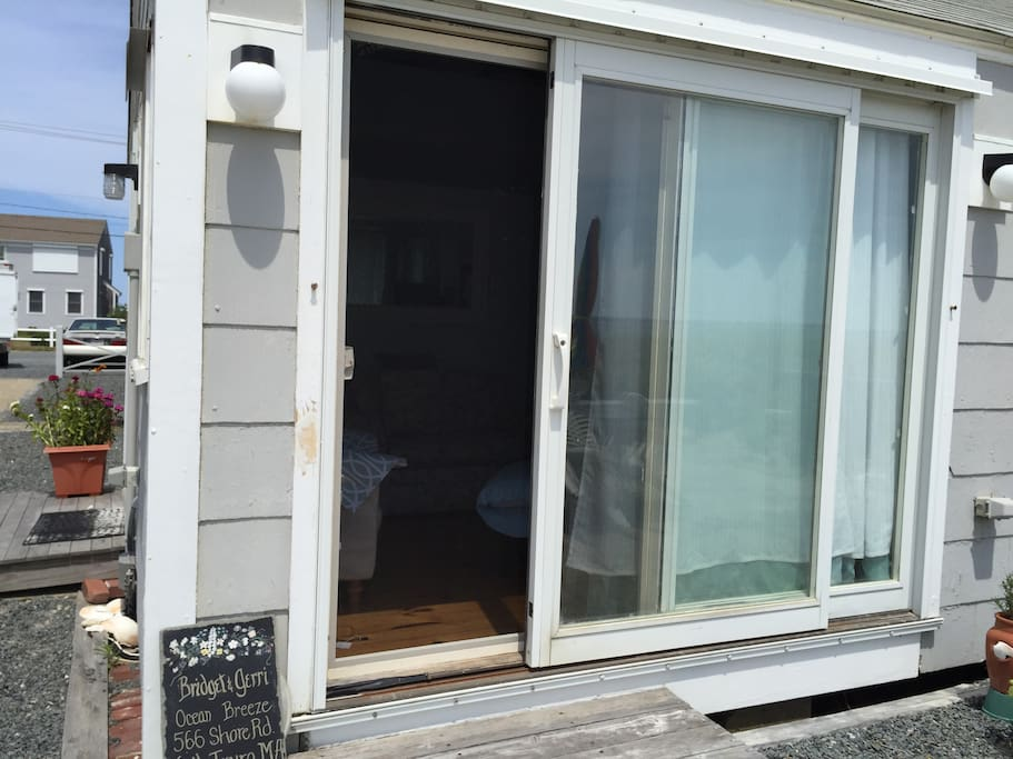our slider opens onto patio which leads to private beach