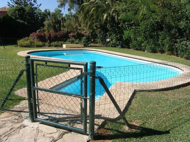 Fenced swimming pool for security