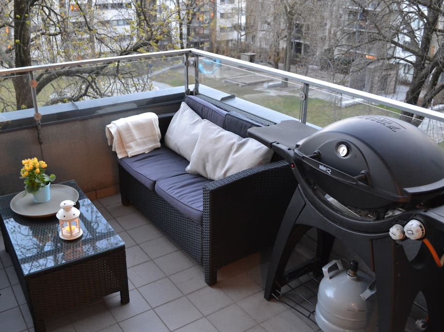 Large balcony with furniture and gas operated barbeque.