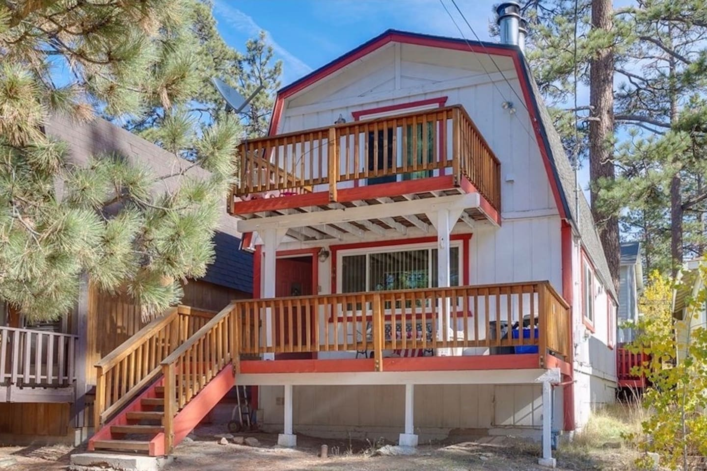 View from the street. Two decks in the front with awesome views of the woods!