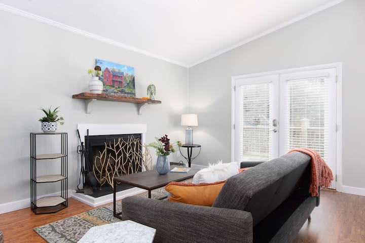 """Living Room has Wood Burning Fireplace, Vaulted Ceilings, and a Brand New 55"""" Smart Television with Premium Cable Package."""