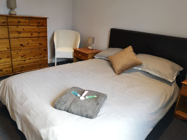 Main bedroom to the front of Daves house is spacious , this room has a double bed a large pine wardrobe, pine bedside cabinets and a large pine chest of draws.