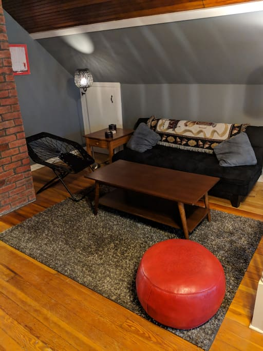 This the the living room. This couch folds down and can be used as another bed. It's smaller then the queen beds but can still fit 2 people.