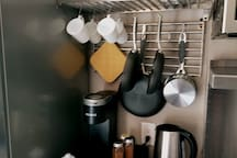 We have many supplies for cooking. There are three mixing bowls and a mixing bowl with a pouring spout and handle. Also, three frying pans easy to reach. We also have many other pots right across from stove in kitchen cabinet.