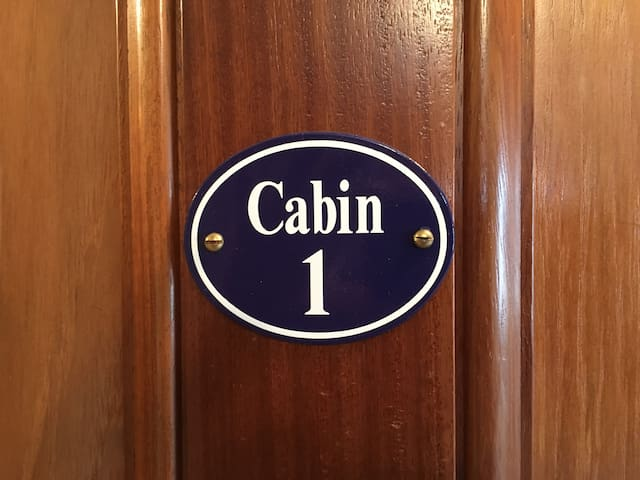 Tower Bridge Houseboat: Cabin 1 enamel door sign. All the doors on The Harpy are panelled mahogany.