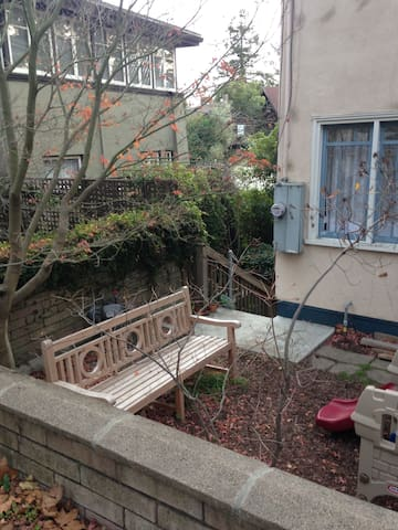 Another view of the side entrance, with a bench for outdoor lounging