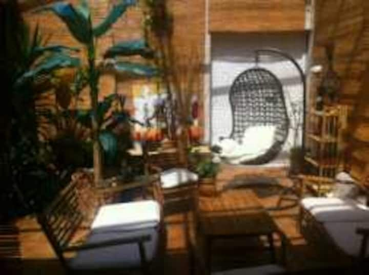 One or 2  rooms in a lovely house- private veranda