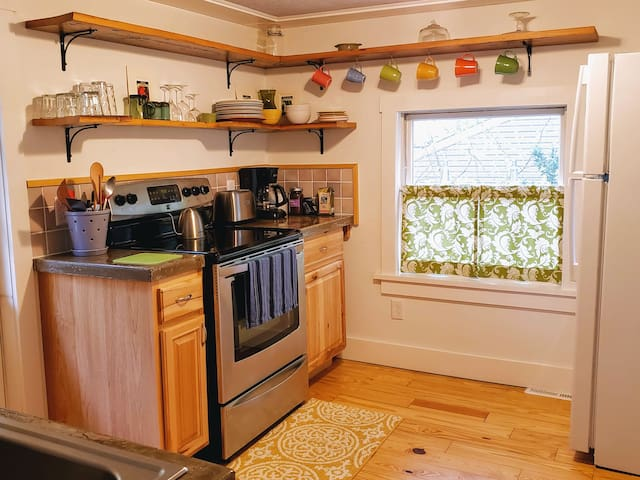 The bright and cheery kitchen has plenty of natural light.