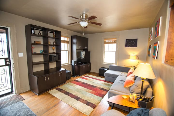 Family room for hanging out or watching tv and sofa that can be an extra bed