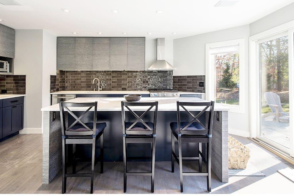 Brand new kitchen with gas stove and subzero fridge