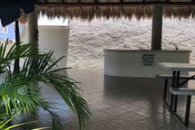 Cabaña con baños y regaderas en zona común del condiminio