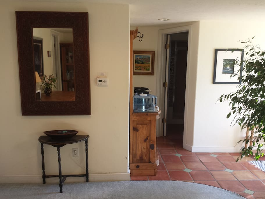 Looking towards bathroom and entry