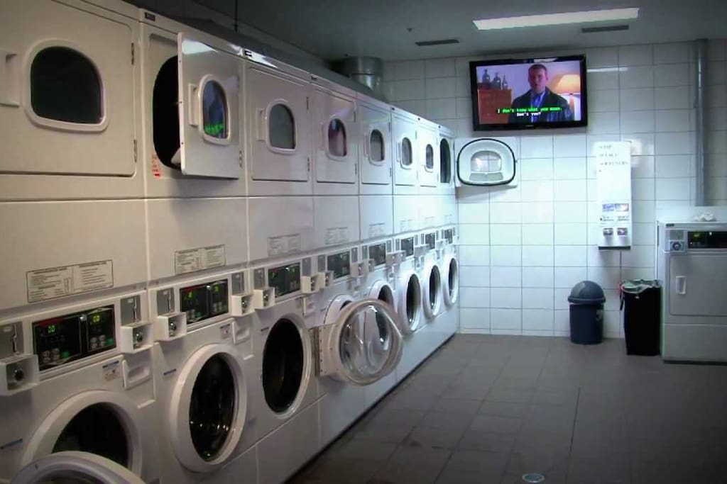 Coin operated laundry with washer and dryer.
