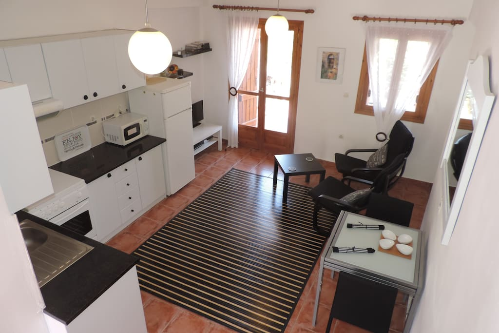 Lounge and Kitchen Area. Fully Equipped. Satellite TV, DVD Player. Doors lead onto The Lower Terrace.