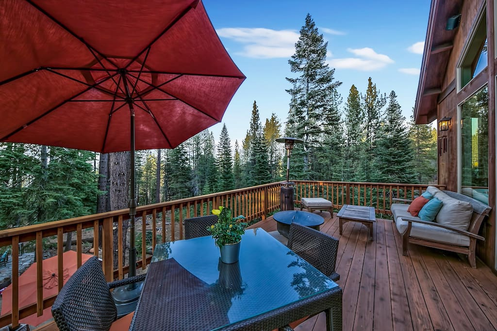 The home is located in the 'Country Club Estates' area and has incredible views of the forest from the back deck.