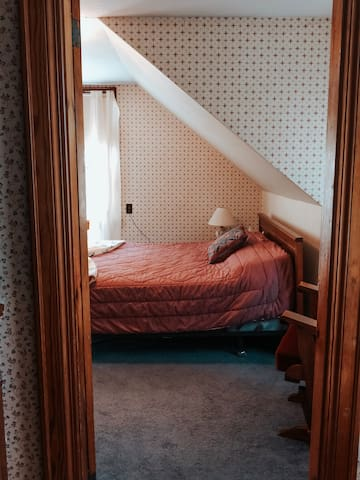 Master Bedroom.  Double bed, dresser with mirror