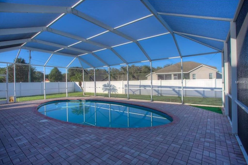 Relax out back on the screened in patio by the pool, or just jump in for a swim!