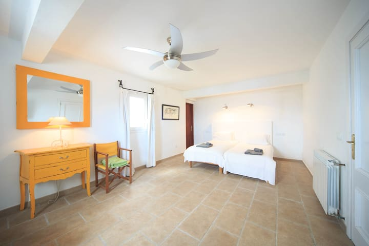 A twin bedroom with separate entrance and air conditioning