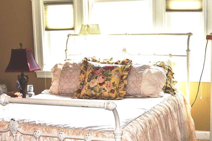 A sumptuous queen bed...there is a cozy fireplace nearby or an amazing antique fan that boasts great air flow as well as a ceiling fan!