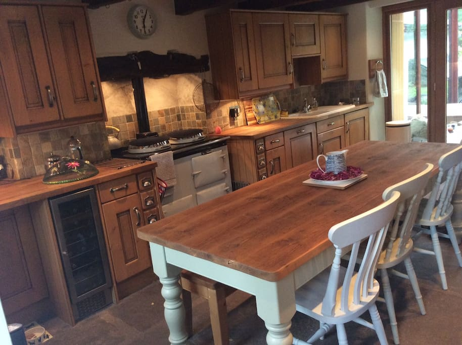 Warm and cosy farm house kitchen with Aga, the hub of the home.