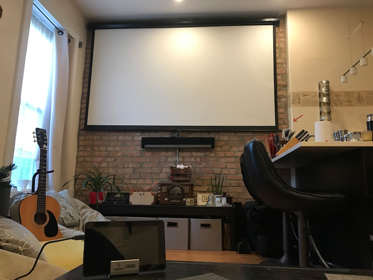 Huuuge projector screen with Apple TV, Amazon Fire TV and even an Xbox. SONOS system throughout apartment.