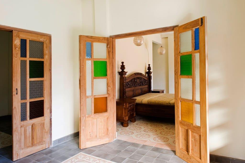 Nice coloured glass door to the master bedroom
