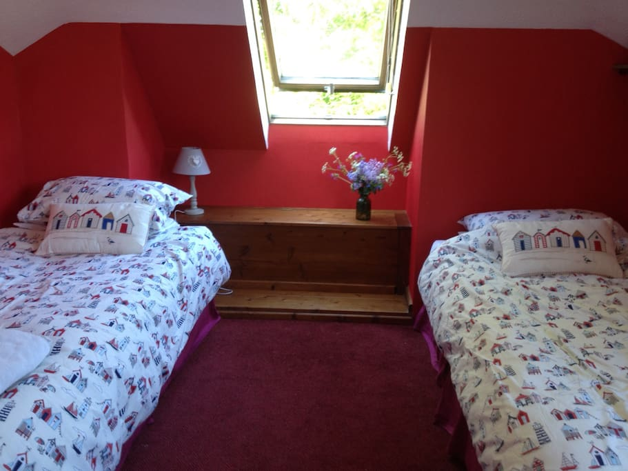 Twin beds, with window looking onto park