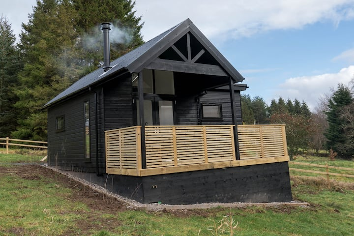 Cabin, with deck and outside bath in woodlands