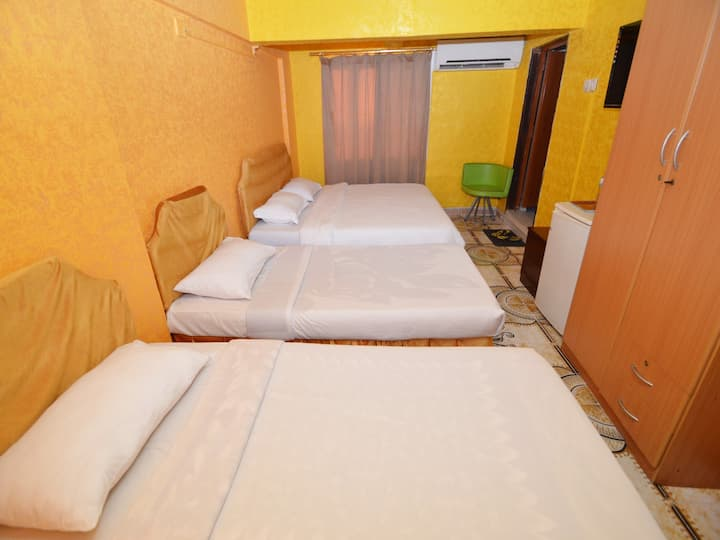 Quadruple Room- one large bed and 2 single beds