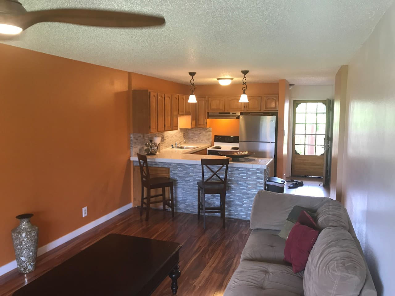 Open living room and dining space.  Wonderful ocean breezes.  A/C unit,  Koa wood ceiling fans.  Samsung smart tv, Vizio sound bar, Samsung blue ray player.  High speed internet and Netflix provided.