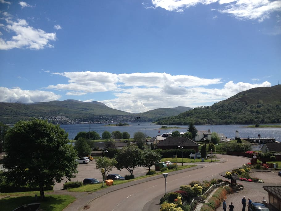 View of the Caledonian Canal with a cruise ship, Loch Linnhe, Corpach Basin and The Jacobite Steam Train