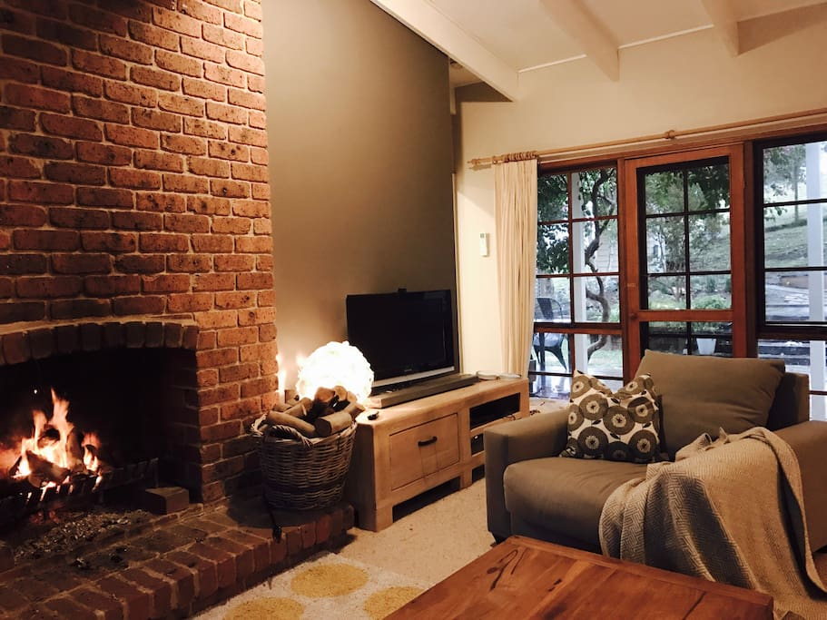 Enjoy the views, a movie or a glass of red in front of an open log fire in the comfortable lower lounge