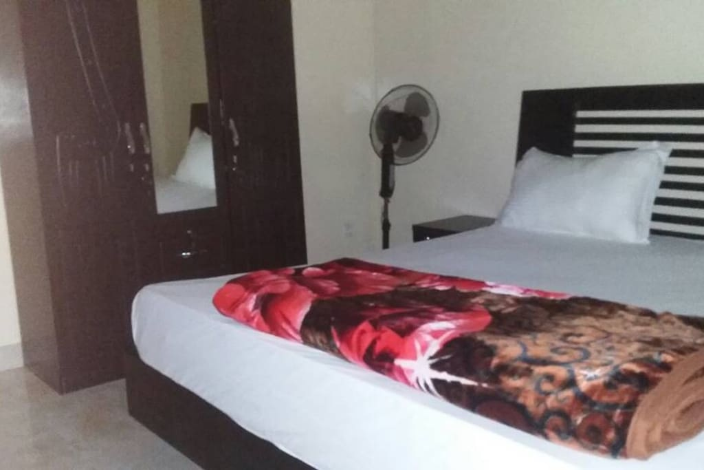 Comfortable king size bed and wardrobe
