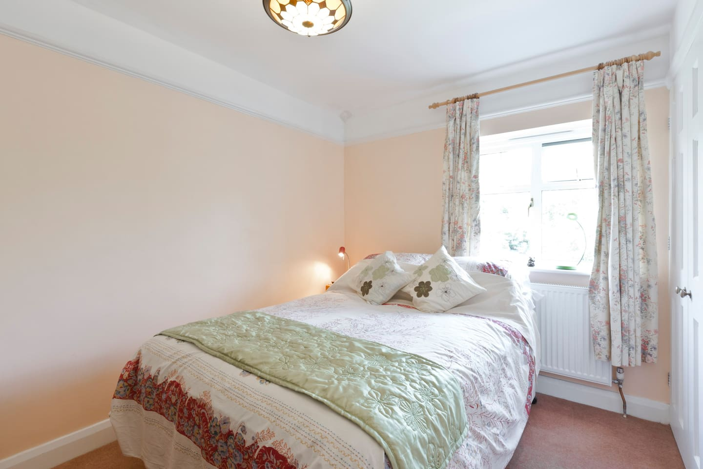The bedroom, with comfortable mattress, fresh cotton sheets, comfy pillows and soft, lightweight quilt.