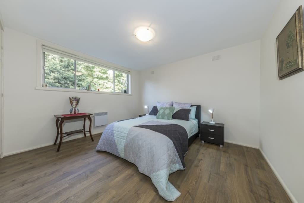Large Queen size bed with built in cupboards