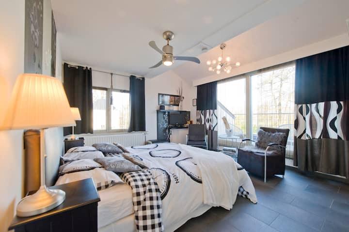 Romantische suite met privéterras en dubbel bad.