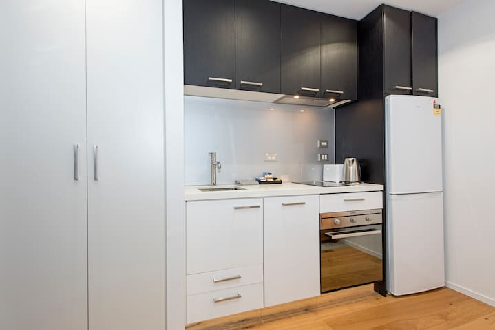 Whip up a something to eat in this compact kitchen.