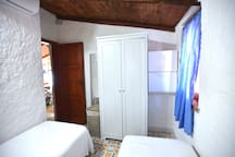 Bedroom 2. The 2 single beds can be put next to each other for a couple.