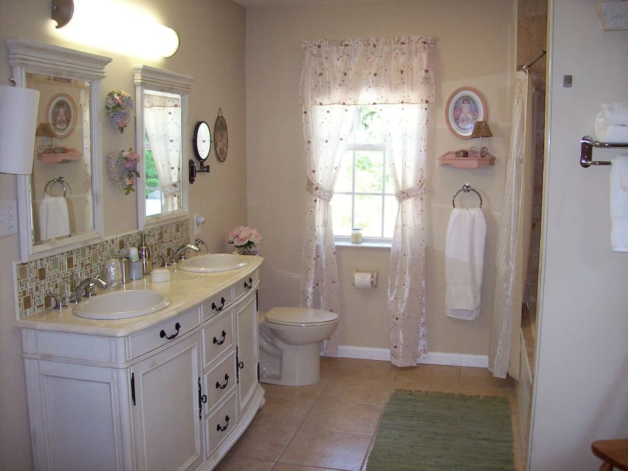 Double sink marble vanity, tub/shower combo, Jet tub, tile floor
