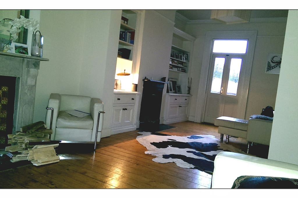 Large open sitting room with simple furnishings. Real fireplaces.